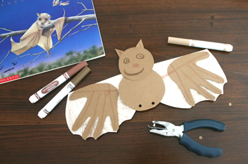 Hand Wing Bats Craft a brown bat made with hand wings and a smiley face